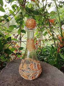 Bottle with lace