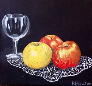 Glass and apple