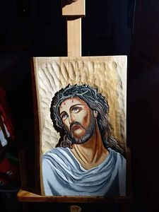 Jesus carving wood