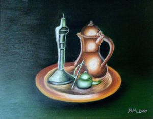Kettle and candle on plate
