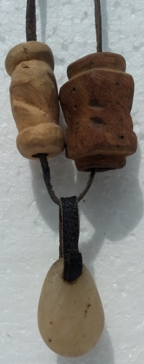 Necklace with a stone pendant and a wooden bead