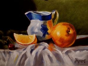 Pitcher and oranges
